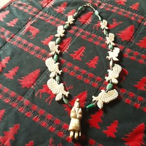 Hand carved totem necklace